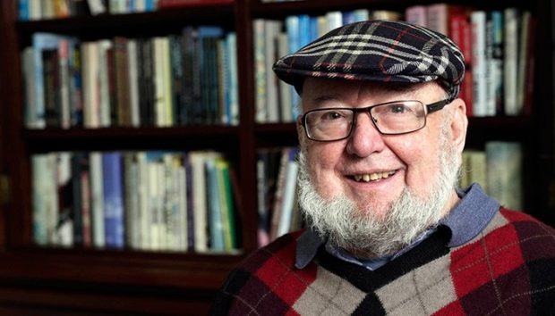 Tom Keneally wearing a hat in the Tom Keneally Centre
