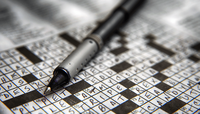 cryptic crossword with pen