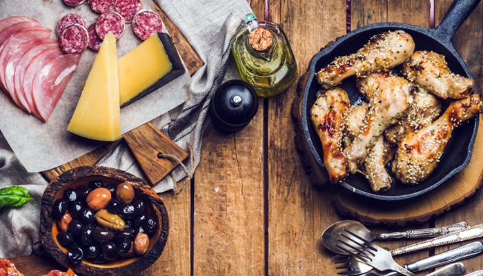 Rustic slow food revolution - table set with meat, cheese, snacks, wine